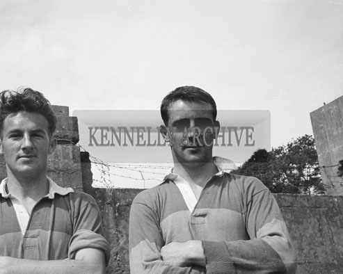 August 1962; Two members of the Kerry Team pose for the camera.