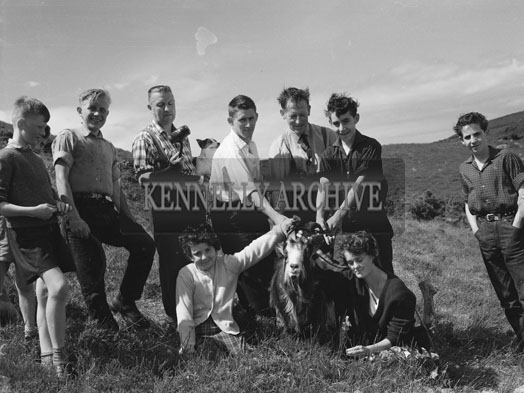 5th August 1962; A group of people pose with the puck after it is captured on the slopes of Carrantuohill.
