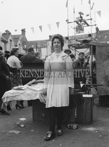 10th-12th August 1962; A woman in an Irish Dancing Costume poses for the camera at Puck Fair in Killorglin.