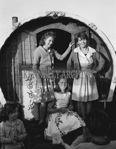 10th-12th August 1962; A group of people pose for the camera outside a caravan at Puck Fair in Killorglin.