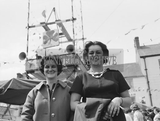 10th-12th August 1962; Two women pose for the camera at Puck Fair in Killorglin.