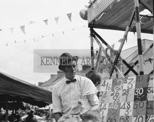 10th-12th August 1962; A man poses for the camera at Puck Fair in Killorglin.
