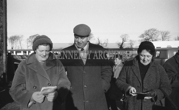 24th December 1962; A group of people pose for the camera at a coursing event which took place at Ballybeggan Park.