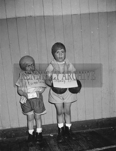 30th December 1962; Two children who took part in the Festival Of Kerry Fancy Dress poses for the camera in costume at the C.I.E. Hall in Tralee.
