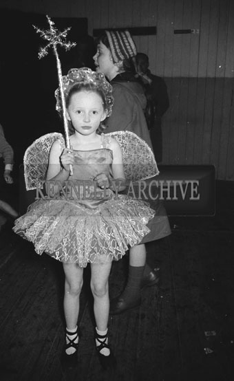 30th December 1962; One of the children who took plart in the Festival Of Kerry Fancy Dress poses for the camera in costume at the CIE Hall in Tralee.