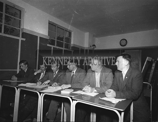 August 1962; Dennis Foley, (third from right) at a meeting which took place at an unknown location.