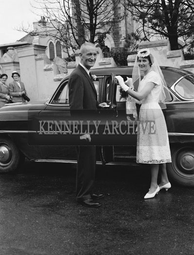 August 1962; A photo taken at a wedding in Ballyheigue Church, followed by a reception at home.