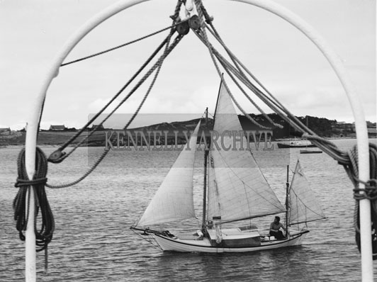 31st August 1962; Paul Johnson from the Shetland Islands arrived in Fenit after a year at sea in his 19ft Sailing Boat. He had to wait out some stormy weather for the oportunity to set off on his 700 mile homeward journey.