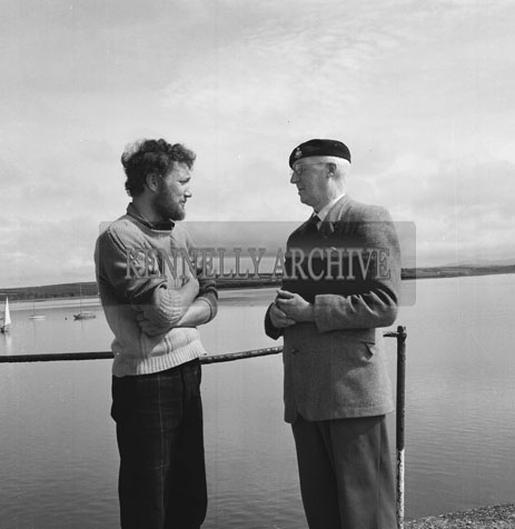 31st August 1962; Paul Johnson from the Shetland Islands shaking hands with Commander Barrett. He arrived in Fenit after a year at sea in his 19ft Sailing Boat. Paul had to wait out some stormy weather for the oportunity to set off on his 700 mile homeward journey.