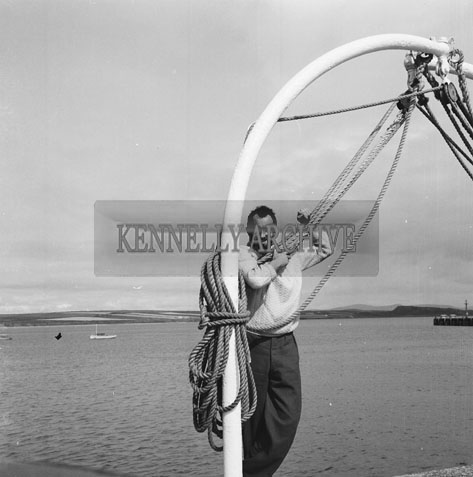 31st August 1962; Padraig Kennelly in Fenit when Paul Johnson from the Shetland Islands arrived after a year at sea in his 19ft Sailing Boat. He had to wait out some stormy weather for the oportunity to set off on his 700 mile homeward journey.