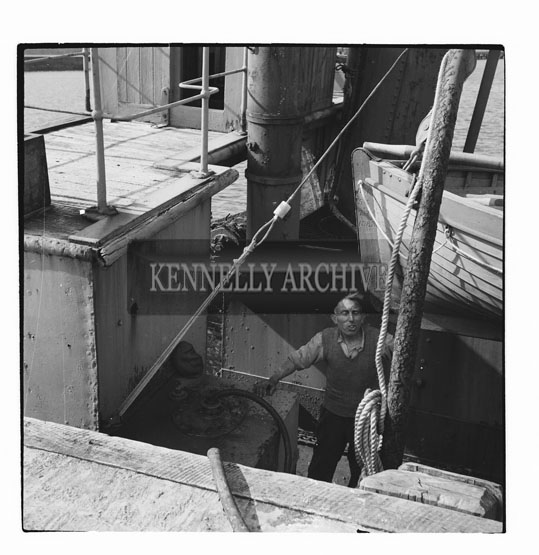 7th September 1958; A crewman aboard the SS Samphire (the local dredger) which had to anchor at Fenit due to a crew problem which cancelled her sailing plans and arrangements had to be made to tow it to Cork.