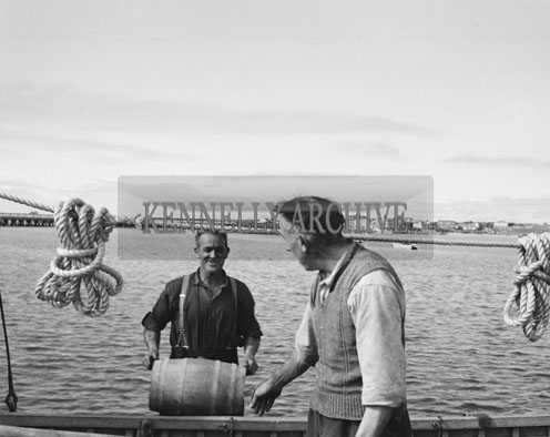31st August 1962; A photo of two men taken at Fenit Pier after the arrival of Paul Johnson from the Shetland Islands. Paul arrived in Fenit after a year at sea in his 19ft Sailing Boat. He had to wait out some stormy weather for the oportunity to set off on his 700 mile homeward journey.