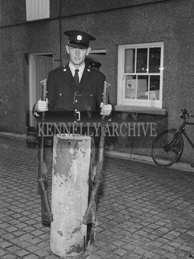1st September 1962: A dump containing two Lee Enfield Rifles, a Webley Revolver and about 80 rounds of ammunition was found at Poulawaddra, Farmer's Bridge. The discovery was made during one of the most intensive searches ever carried out by the Gardai in the country. The search was led by Supt E McDonnell. The dump was found by Garda Tim O'Rourke in a large sewer pipe built into a stone fence dividing two farms. About 80 Gardai armed with mine detectors, probing bars and shovels began a five square mile search from Ballyseedy Memorial to the Sliabh Mish Mountain where they found gelignite. It was believed the find related to a shooting that took place in the Ballyseedy Area.