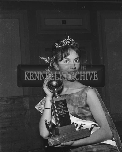 3rd September 1962: The Dublin Rose Ciara O'Sullivan who was crowned Rose Of Tralee at the Ashe memorial hall. The trophy was presented on behalf of the New York Committee by Kevin Coffey.