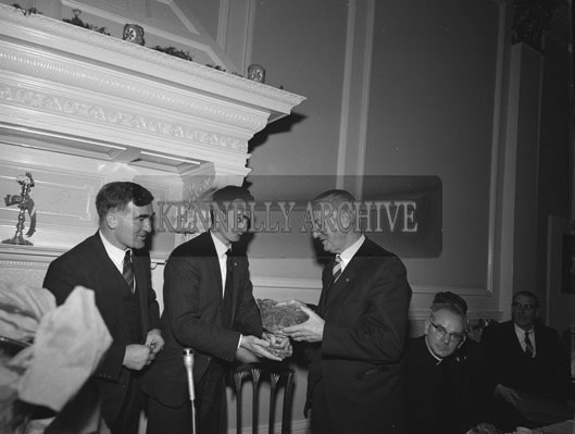 30th December 1962; Sean Og Sheehy presents a trophy to Dr Eamonn O'Sullivan as Dr Jim Brosnan looks on at the Annual GAA Dinner in the Great Southern Hotel, Killarney.