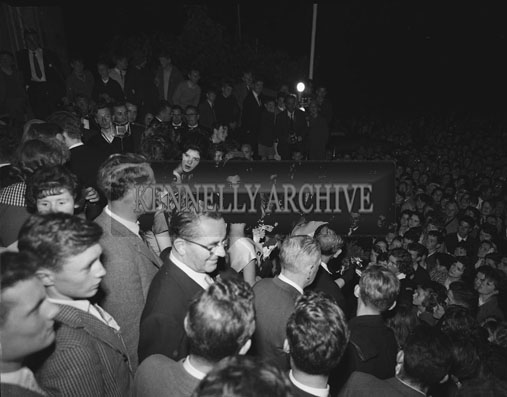 3rd September 1962: The crowd look on as the Dublin Rose Ciara O'Sullivan is crowned Rose Of Tralee at the Ashe Memorial Hall. The trophy was presented on behalf of the New York Committee by Kevin Coffey.
