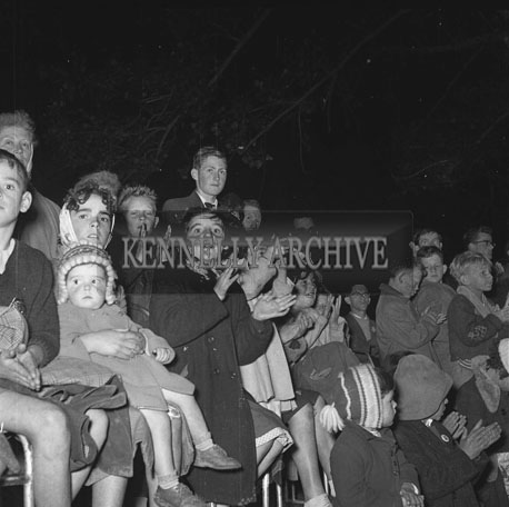 4th September 1962: A crowd of people gather in the Town Park to watch Fossetts Open-Air Circus.