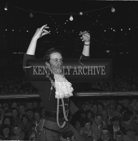 4th September 1962: A member of the London Girl's Pipe Band on the open-air platform in Denny Street in Tralee.