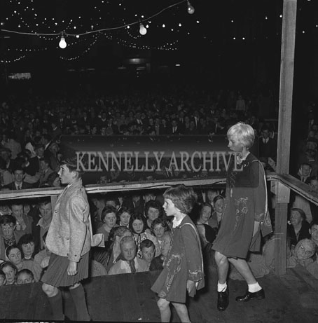 4th September 1962: Champion Irish Dancers from London Loretta, Sandra and Eugene Murphy entertain the crowd in Denny Street,Tralee during the Festival of Kerry.