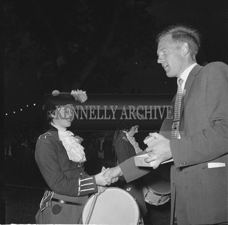 6th September 1962; A member of the South London Girls Pipe Band receiving a medal at the Town Park in Tralee during the Festival Of Kerry.