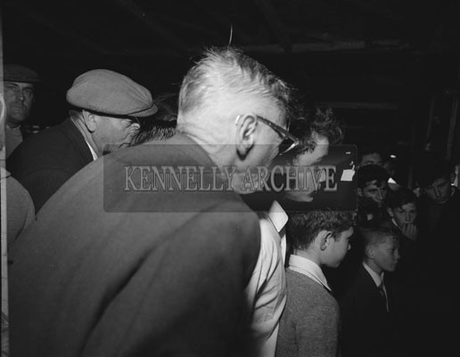 September; A group at an unknown location watching the 1962 All-Ireland football final between Kerry and Roscommon.