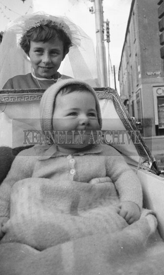 19th September; A photo of a baby in a pram taken on Confirmation Day in Castleisland.