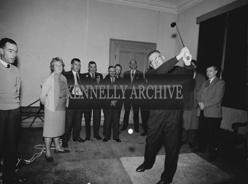 October 1962; Club Captain Ned Fitzmaurice tests ot the new indoor net at Tralee Golf Club. The net was created by Pat Smyth for indoor practice during the winter.