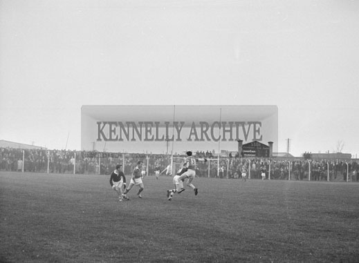 21st October 1962; An action photo taken at the Senior County Football Final between Feale Rangers and John Mitchels. The game ended in a draw with the final score John Mitchels 1-11 and Feale Rangers 2-8.