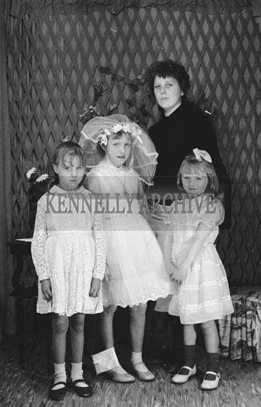 27th June 1964; A Girl and Her Family Posing For The Camera on Her Communion Day.