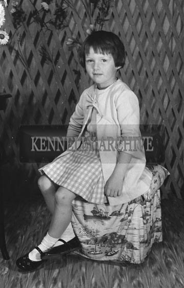 27th June 1964; A Girl Posing For The Camera on Communion Day In Tralee.