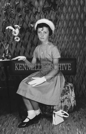 27th June 1964; A studio confirmation photo of a girl.