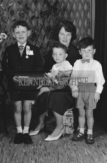 27th June 1964; A Boy And His Family Posing For The Camera on His Communion Day.