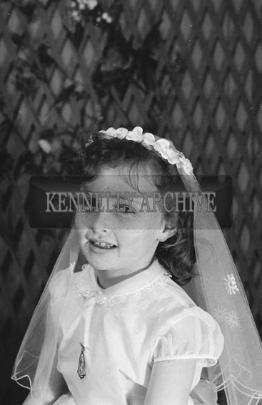 27th June 1964; A Girl Posing For The Camera on Her Communion Day.