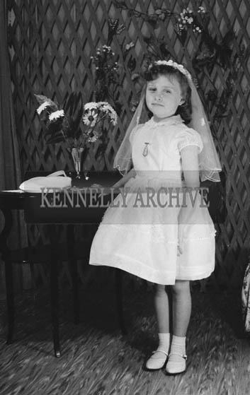 27th June 1964; A Girl Posing For The Camera on Her Communion Day