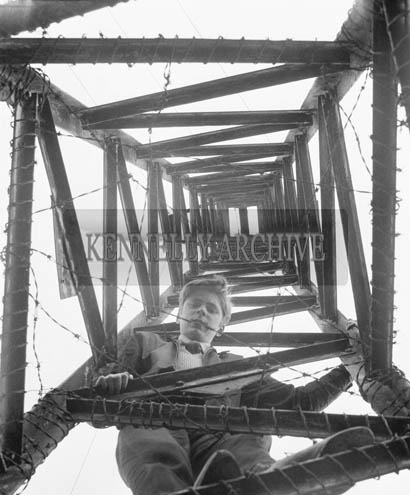 25th April 1964; Photo of Local Hero Peter Locke who saved a young boy's life. Denis Fitzgerald, a 9 year old schoolboy from Mitchel's Crescent, had a narrow escape from death when he climbed a 35 foot high ESB pylon at Clonmore and touched the high tension cable. For 10 minutes his life was held in the balance by the instep of his foot which was jammed in one of the steel bars of the pylon preventing him from falling to the ground. In the meantime, another schoolboy, 13 year old Peter Locke rushed to the scene and without consideration for his personal safety, climbed the pylon in an effort to rescue his neighbour. Locke moved to a position higher than Fitzgerald and grasped him by the back of the neck. When he had a firm grip he released the trapped foot. Then he brought Fitzgerald slowly down to safety.