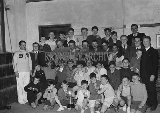 5th May 1964; Officers of The Desmond Boxing And Youth Club with some of the members who received prizes at a function held in the Club Rooms. Front Row (L-R): T Houlihan, P Fitzgerald, A O'Sullivan, M O'Sullivan, P McGillcuddy, R Houlihan, P Cregan, M Fitzgerald. Second Row (L-R): P Moriarty, T Fitzgerald, A Raymond, L O'Brien, T Conway, M O'Sullivan, M O'Brien, T Moriarty, P Lyons, J Brassil. Third Row (L-R): W Doyle, C Lynch, J McElligott, M Murphy, B Baldwin, T Browne, B Brosnan, S O'Connor, P Maguire, B Burke, L Brassill (Secretary). Fourth Row (L-R): S O'Brien, D O'Sullivan, V Walsh, S Kissane, J Smith, D Houlihan, T O'Sullivan, M O'Sullivan, PJ Cournane.