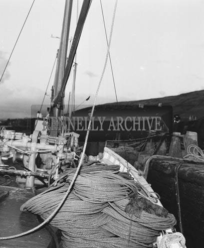 15th May 1964; Skipper Christy O'Shea, a 41 year old man from Valentia, received a cheque for 750 Pounds from Bord Iascaigh Mhara as an incentive bonus for paying off a 9,000 Pound debt on his boat 'Ros Airgead', inside 10 years.