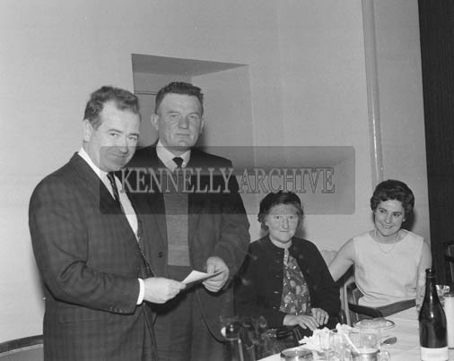 15th May 1964; Skipper Christy O'Shea, a 41 year old man from Valentia, receiving a cheque for 750 Pounds from Bord Iascaigh Mhara Chairman Mr Brendan O'Kelly, as an incentive bonus for paying off a 9,000 Pound debt on his boat 'Ros Airgead', inside 10 years.