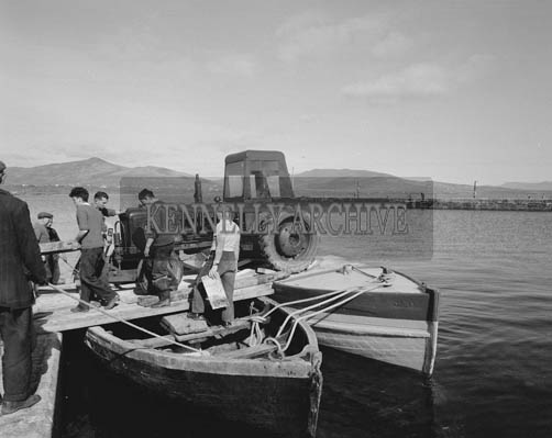 May 1964; A photo taken of a tractor being ferried on two boats to Valentia.