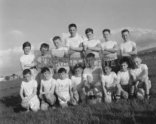 May 1964; Cahill's Park, winners of the Kerin's O'Rahillys Under 13 Football League Final for the Fatherr Drummond Cup. Back Row (L-R): Eugene Healy, Richard Houlihan, Liam O'Brien, Paddy Kissane, Eugene Moriarty, Eamonn Dineen, Tom Collins. Front Row (L-R): Tim O'Brien, Johm Fitzgerald, Johnny Houlihan, Pat Cregan, John O'Sullivan (Capt.) Denis Dineen, Sean Dineen, Johnny Conway.