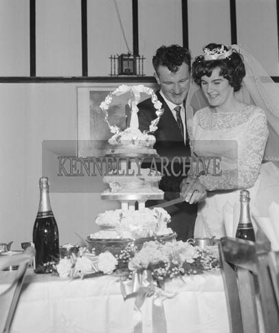May 1964; A photo taken of the wedding couple cutting the cake at their reception held in Benners Hotel in Dingle.