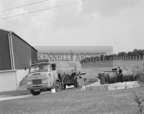 25th May 1964; The official opening of the Kerry Precision Ball Bearing Company in Tralee, attended by the Minister for Industry and Commerce Mr Jack Lynch. Kosangas being uploaded at The Precision Ball Bearing Company in Tralee.