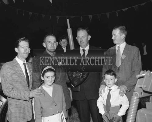 26th May 1964; Connie Nolan holding a shield at the Kingdom County Fair in Tralee. Horan's Garage received a trophy for the Best Industrial Exhibit in the parade during the opening of the Kingdom County Fair. The Tralee garage paraded a 40 year old Austin 7 crewed by Johnny O'Shea and Eamon Horan in period costume.