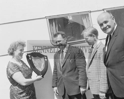 26th 1964; Mr Jack Daly of Killarney Autos, receiving the shield for the Most Novel Exhibit at the Kingdom County Fair Parade from Mrs Helen Brassil (Secretary of the Tralee Development Association). Also in the picture is Mr Matt McQuaid, General Manager of Standard Triumph (on left) and Mr Billy Daly of Killarney Autos.