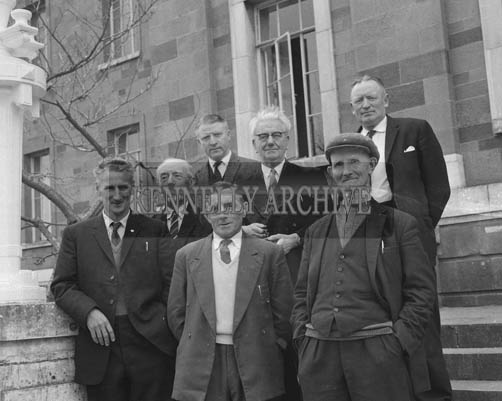 June 1964; James O'Connor, Tom Cooper, Jack O'Shea and Johnny Buckley were among the members of The Jarvey's, Taxi-Men's, Boatmen's and The Gap Of Dunloe Ponymen's Association who appealed to Kerry County Council to support them in their fight against the action of CIE in introducing special buses to Killarney to provide sightseeing tours, traditionally carried out by the members of the Association. The photograph was taken outside the Ashe Memorial Hall.