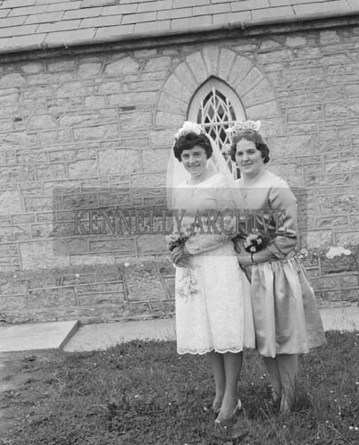 June 1964; A photo taken of the bride and her bridesmaid on her Wedding Day in St Catherine's Church in Tralee.