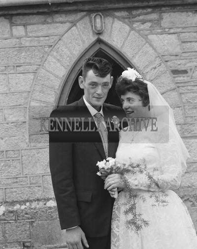 June 1964; A photo taken of a wedding couple on their Wedding Day in St Catherine's Church in Tralee.