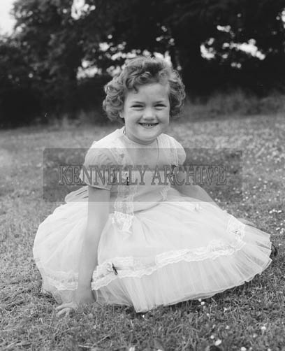 June 1964; A photo of a girl at a wedding in Ballybunion.