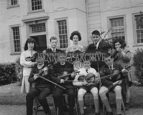June 1964; Nine students from Micheal O'Duinn's music class in the Technical School in Tralee who passed the Royal Irish Academy of Music Examination. Front from left: Patrick Stack, Tom O'Brien, Padraig O'Foghludha and Diarmaid O'Foghludha. Back L to R: Mary Hogan, Sean P McCarthy, Joan O'Reilly, Joseph O'Shea and Ann Taylor.