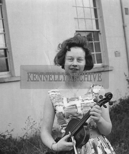 June 1964; Violin student Joan O'Reilly from Micheal O'Duinn's music class in the Technical School in Tralee who passed the Royal Irish Academy of Music Examination.